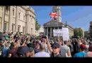 Demonstrators in Trafalgar Square protest mask regulations