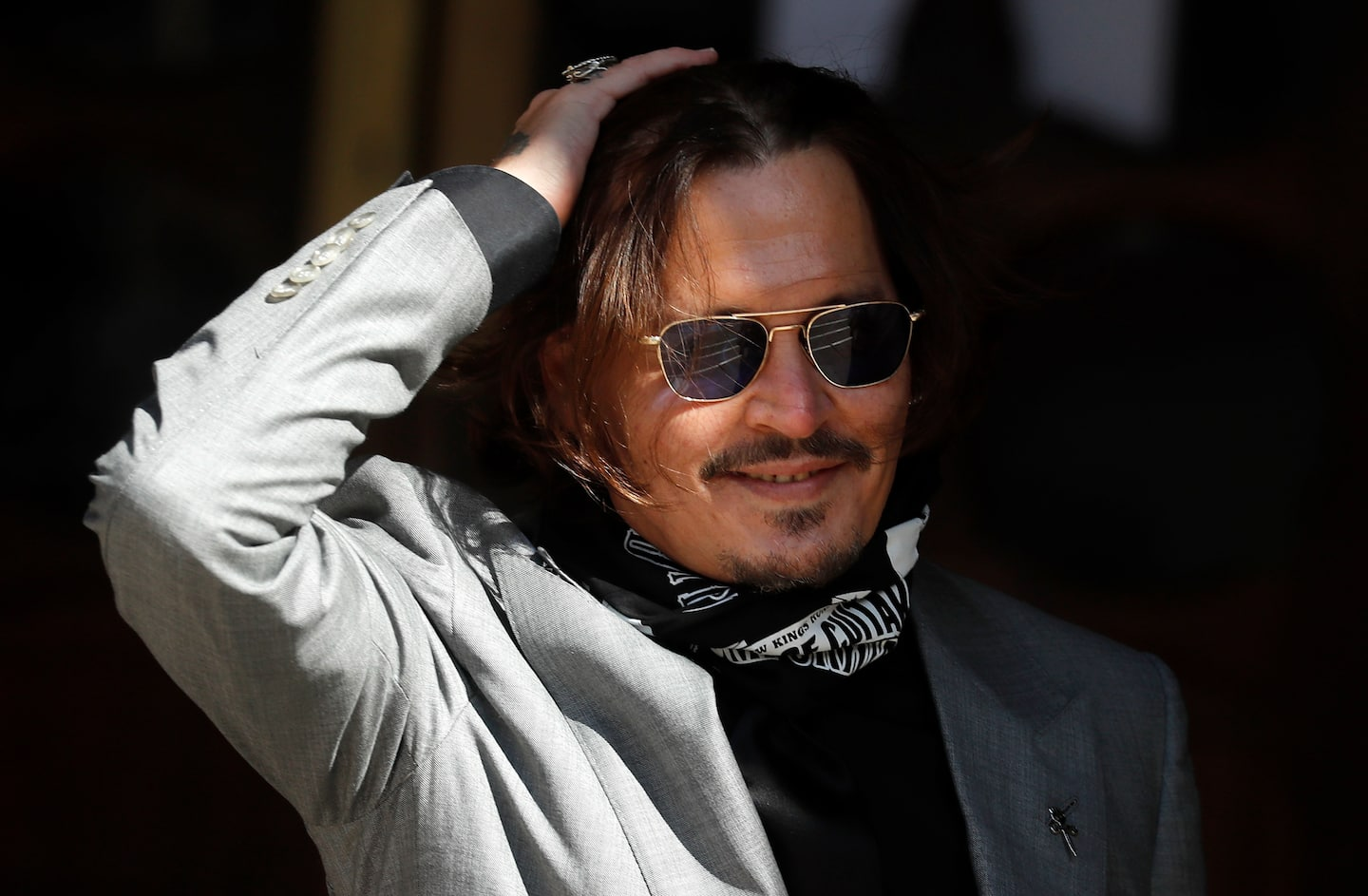 Johnny Depp loses defamation suit against Sun tabloid over wife beater accusation
